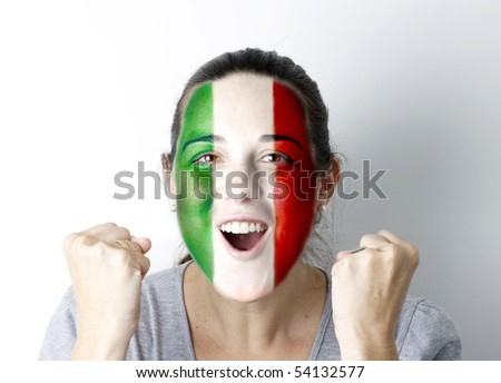Italian fan screaming GOAL with hands up and painted flag on her face.