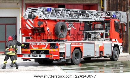 Italian firefighters during exercise in fire station - stock photo