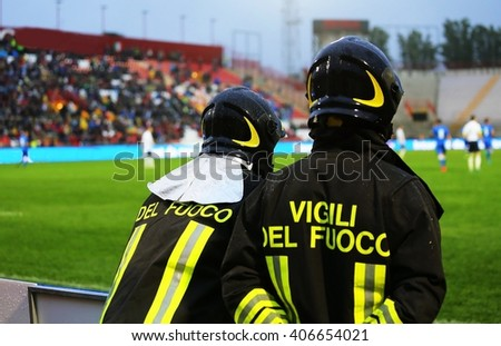 Italian firefighters with wirtten Vigili del Fiuoco (Fireman of Fire Department in italian) during the sports event at the stadium