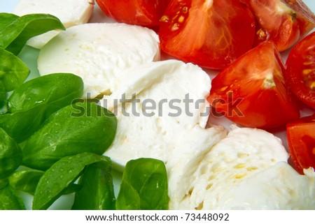 Italian flag made with Tomato Mozzarella and Basilil - stock photo