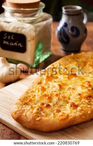 Italian focaccia bread with rosemary, garlic, sea salt, olive oil and mozzarella - stock photo