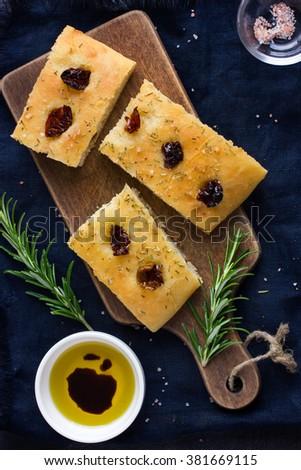 Italian focaccia bread with sun dried tomatoes, top view - stock photo