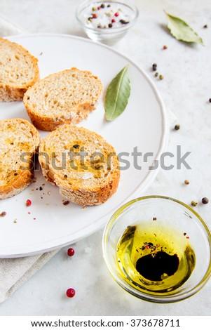 Italian food appetizer - ciabatta bread with olive oil, spices, balsamic vinegar and sea salt - stock photo