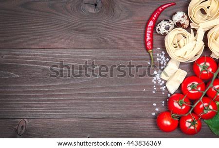 Italian food background on rustic wood board - stock photo