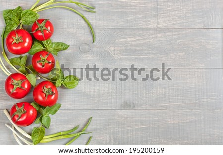 Italian food background with tomatoes, basil and green onion