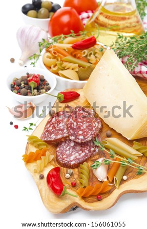 Italian food - cheese, sausage, pasta, spices, tomatoes, isolated on white