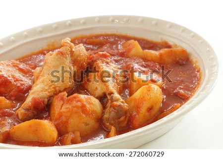 Italian food, chicken and potato simmered with tomato - stock photo