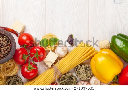 Italian food cooking ingredients. Pasta, vegetables, spices. Top view with copy space - stock photo