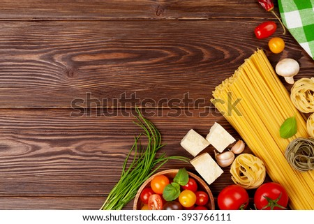 Italian food cooking ingredients. Pasta, vegetables, spices. Top view with copy space