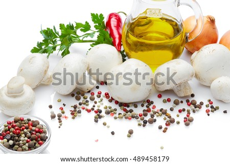 Italian food & drink healthy lifestyle concept: Aromatic fresh mushrooms spices vegetables & herbs. Mushrooms Olive Oil onion parsley & pepper Top view Isolated on white