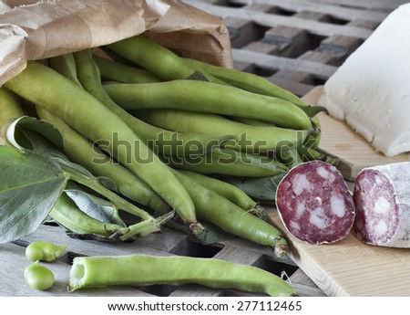 italian food, fave e salame, broad beans with salami and sheep cheese - stock photo