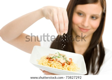 Italian food - healthy woman hold spaghetti with grated cheese sauce - stock photo