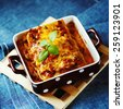 Italian Food. Hot tasty Lasagna plate served with fresh basil leaf. Selective focus. Instagram photo effect. - stock photo
