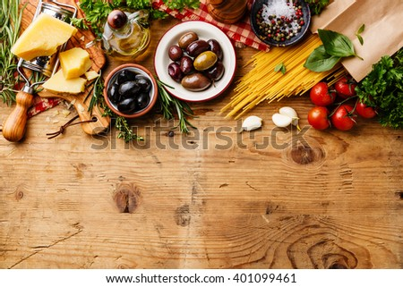 Italian food ingredients and snacks on wooden background - stock photo