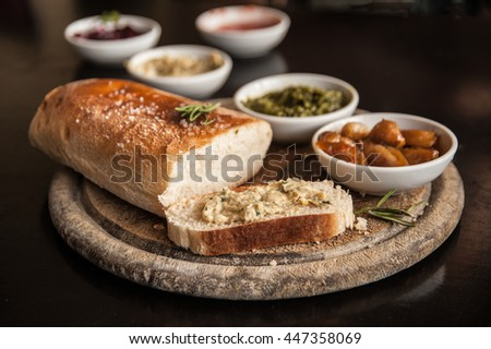 Italian food ingredients background with sliced bread Ciabatta rosemary on wooden board  - stock photo