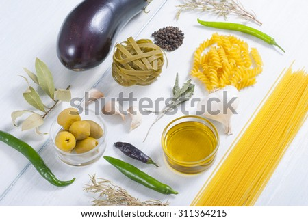 italian food ingredients on white wood table