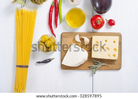 Italian food ingredients on white wood table - stock photo