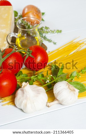 italian food ingredients on white wooden