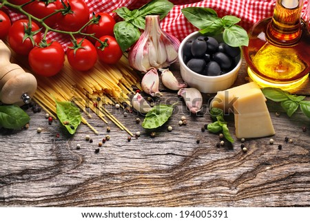 Italian food ingredients on wooden background - stock photo