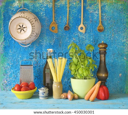 italian food ingredients, spaghetti, tomatoes, herbs, kitchen utensils - stock photo