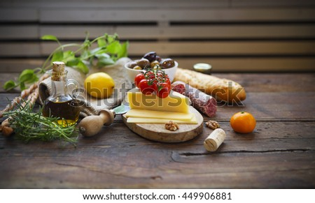 Italian food ingredients with olive oil on wooden background - stock photo