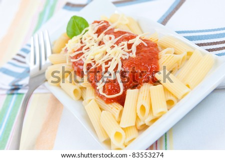 italian food pasta with tomato cheese and basil