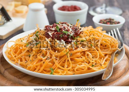 Italian food - pasta with tomato sauce and cheese, close-up, horizontal