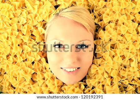 Italian food - portrait of healthy woman in pasta - stock photo