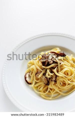 Italian food, Shiitake and Japanese leek linguini - stock photo