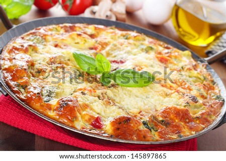 Italian frittata with vegetables and parmesan cheese - stock photo