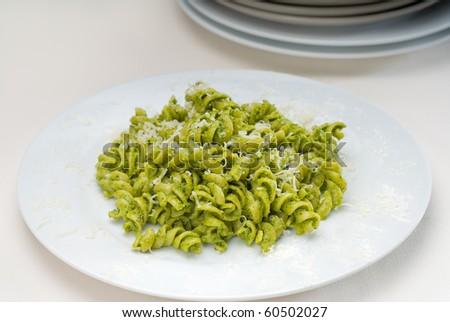 italian fusilli pasta and fresh homemade  pesto sauce - stock photo