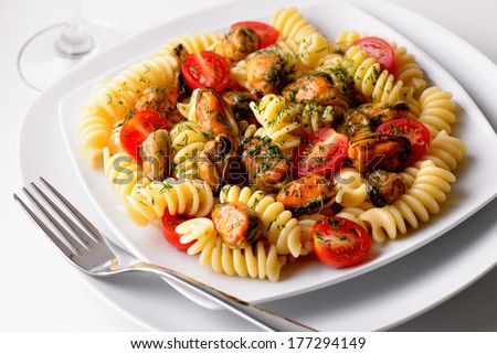 Italian fusilli pasta with mussels, cherry tomatoes and dill