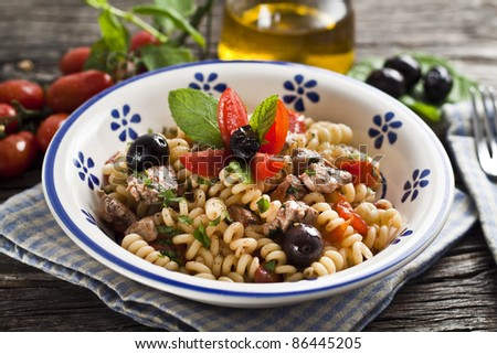 Italian Fusilli pasta with swordfish,olive and raw tomato - stock photo