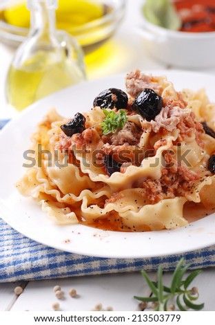 Italian Fusilli pasta with tuna and black olives - stock photo