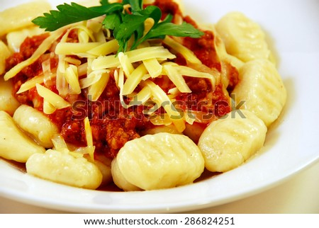 Italian gnocchi delicious holiday dish of potatoes with tomato sauce. - stock photo