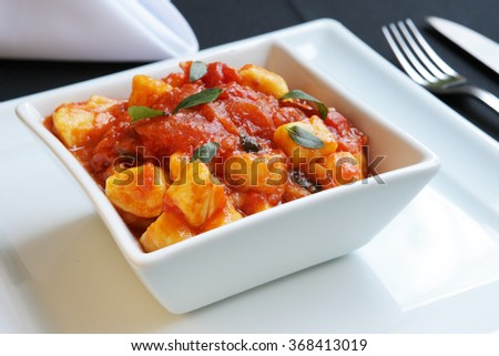 Italian Gnocchi with Red Sauce and Basil - stock photo