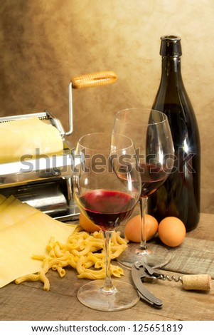italian gourmet with red wine and egg pasta