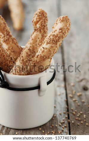 Italian grissini with sesame, selective focus and retro style - stock photo