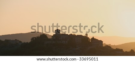 Italian hill-top village at sunrise - stock photo