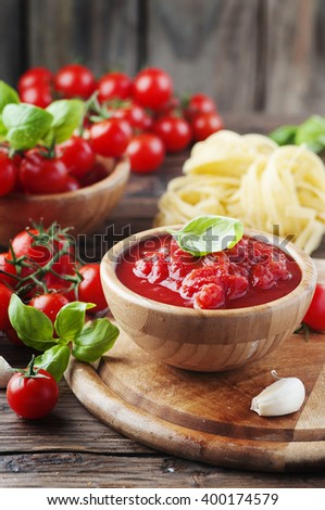 Italian homemade traditional sauce with tomato and basil, selective focus - stock photo