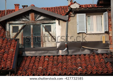Italian house overlooking old tiled roofs