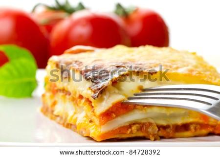Italian lasagna dish with tomatoes - stock photo