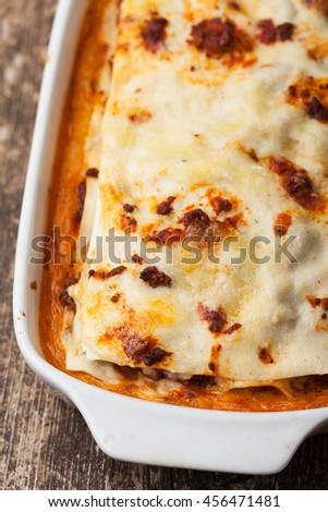 italian lasagna in a baking dish - stock photo