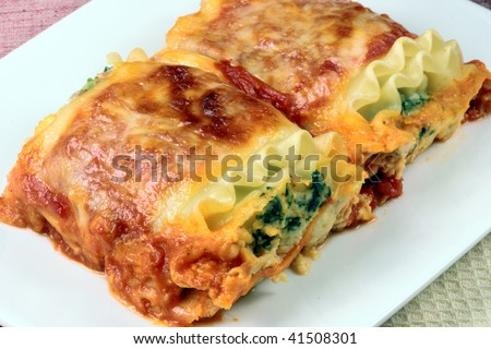 italian lasagna rolls made with tomatoes spinach and ricotta cheese