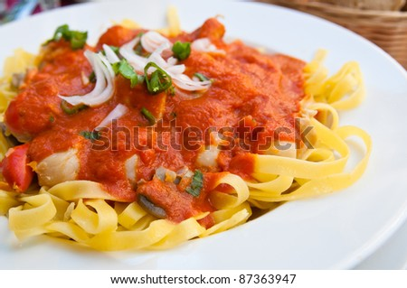 Italian meat sauce noodles on the table - stock photo