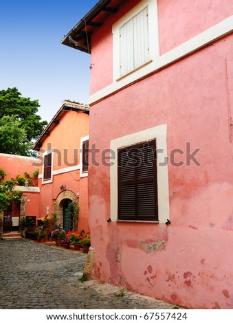 Italian Medieval Courtyard Decorated With Flowers Geranium - stock photo