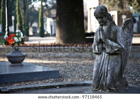 Italian monumental cemetery: collection of two hundreds years old statues - stock photo