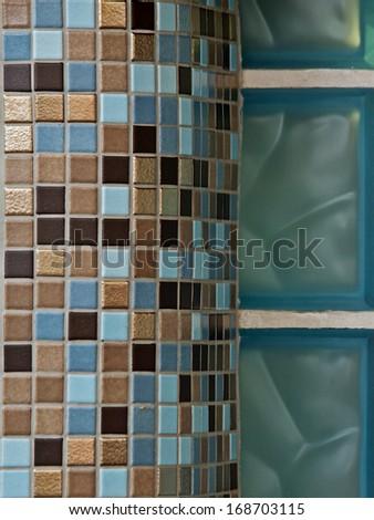 Italian mosaic tiles and glass brick wall - stock photo
