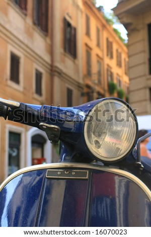 Italian motorbike/scooter in Rome,Italy with buildings to background. - stock photo