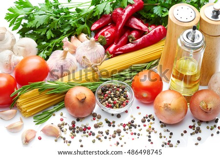 Italian natural food & drink & healthy lifestyle concept: Natural vegetables herbs spices  pasta. Home food. Garlic mushrooms onion pepper tomatoes parsley pasta & olive oil. White background Top view
